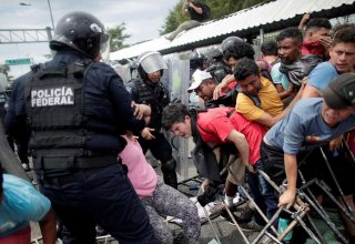 Migrants clash with Greek police at border after Turkey opens floodgates
