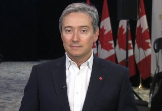Canada's new foreign minister says he pressed China on detainees