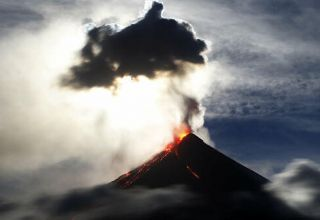 Restive Philippine volcano prompts evacuation of thousands of residents