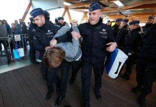 Police detain 185 climate protesters at Brussels car show