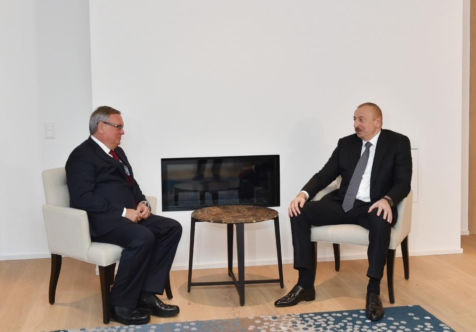 President Ilham Aliyev meets with President and Chairman of VTB Bank Management Board in Davos