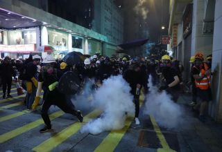 Rioters block traffic, attack passers-by in Hong Kong