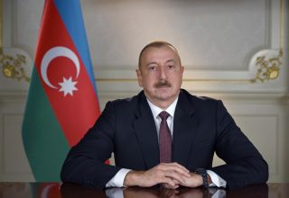 Azerbaijani president awards Turkish FM with Dostlug Order