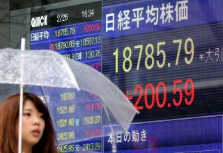 Asian stocks, oil higher as economies emerge from lockdown