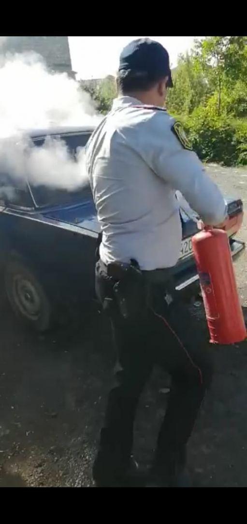 Qubada avtomobildə baş verən yanğın polislər tərəfindən söndürüldü (FOTO/VİDEO) - Gallery Image