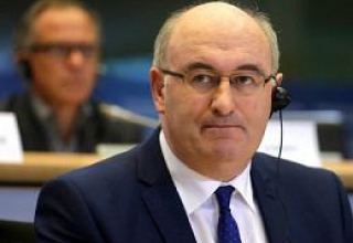 EU trade commissioner Hogan mulling candidacy for WTO chief