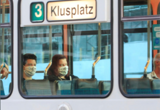 Swiss passengers don masks on trams and mountain trains to fight COVID-19