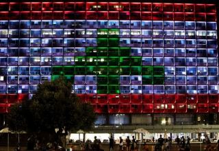 Israeli square bathed in Lebanese colors in rare show of support over Beirut blast
