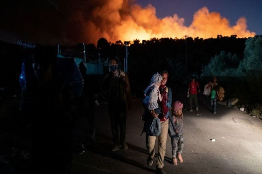 About 9,000 migrants on Greece's Lesbos move into tent camp after fire