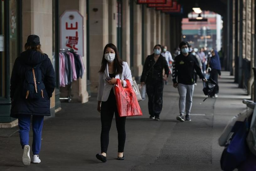 Australia's virus hotspot may speed up lifting curbs as cases fall