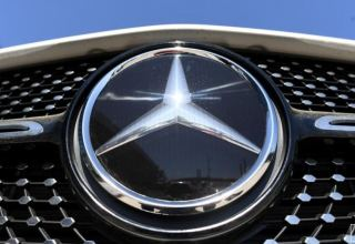 Daimler lifts profit forecast as China snaps up luxury cars
