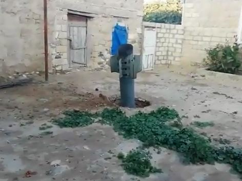 'Smerch' missile launched by Armenia lands in private house garden in Azerbaijan (VIDEO)