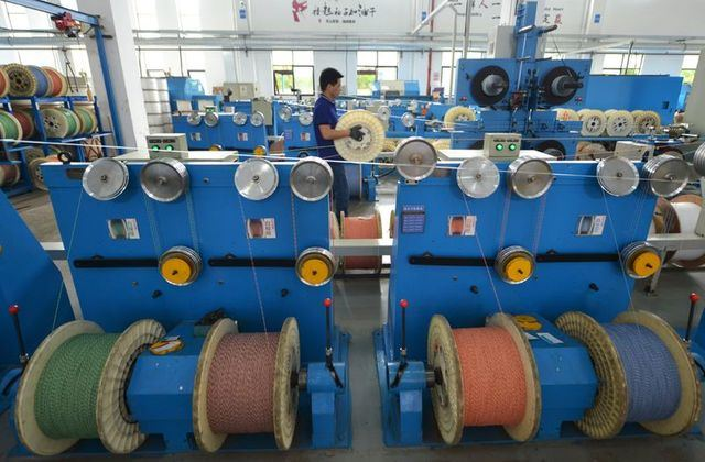 China's January factory activity growth likely slowed as COVID cases rise