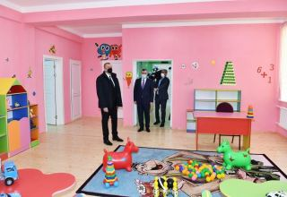 Azerbaijani president takes part in ceremony of providing families of martyrs, disabled with apartments (PHOTO)