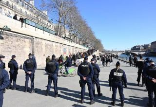 Paris police clear Seine riverside over lack of social distancing