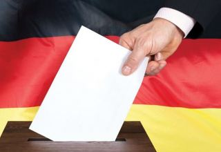 Germany's ruling conservatives move up in polls