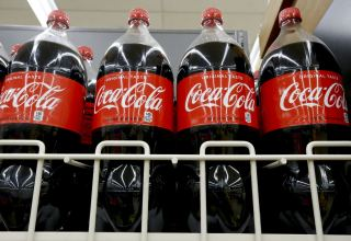 Coca-Cola revenue rises past estimates on easing pandemic curbs