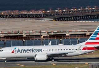 American Airlines loss narrows as travel demand picks up
