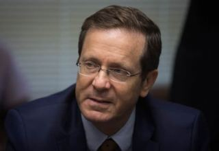 Israel's president gets third COVID-19 shot, urges boosters for over-60s