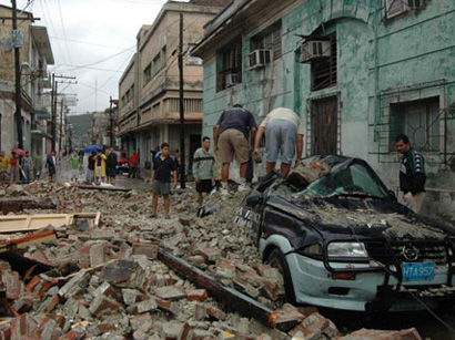 Photo: Sandy kills 6 in Haiti, 11 in Cuba, causes losses in Dominican Republic / Other News