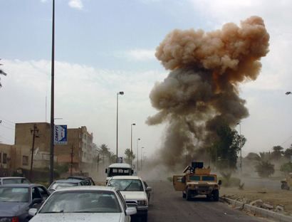 Photo: Deadly blasts, assassination strike Iraq before election / Arab World