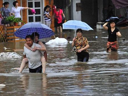 Photo: At least 34 killed in floods, landslides in Philippines / Other News