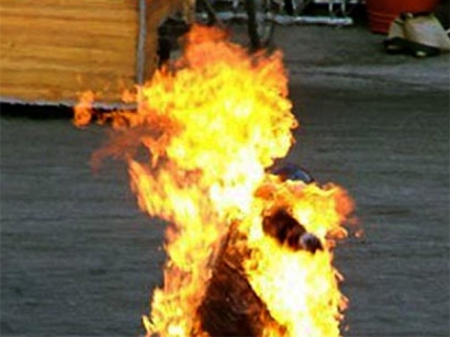 Photo: Iranian citizen committed an act of self-immolation in front of Parliament / Iran