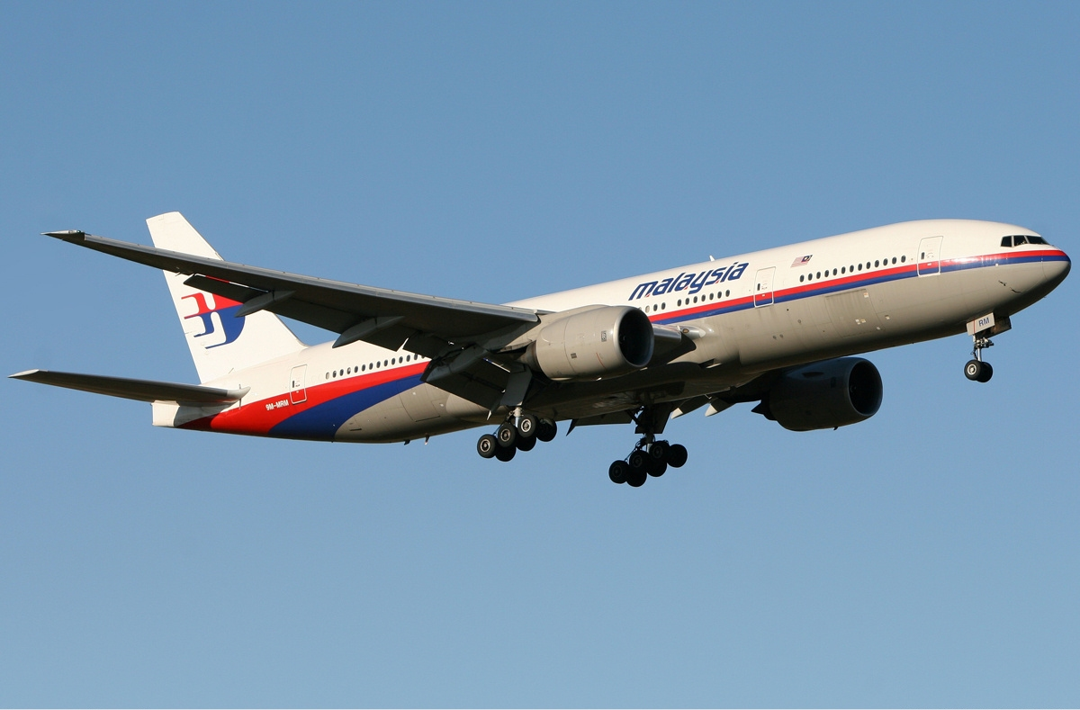 Photo: Search widened as Malaysia air probe finds scant evidence of attack / Other News