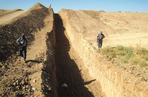 Photo:  Kurds at odds over Syrian border moat  / Arab World