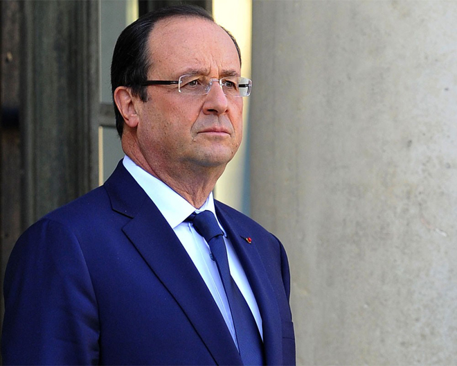Photo: French President says no survivors of Air Algerie crash