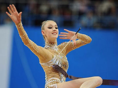 Photo: Russian gymnast wins gold in exercises with clubs at European championship in Baku