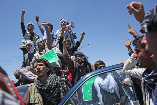 Photo: Supporters of Afghanistan's Abdullah rally after disputed vote