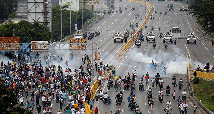Car runs over group of protesters in Venezuela, one person taken to hospital